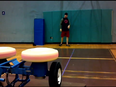 / man practicing catching dodgeballs thrown through pitching machine / he does well at first and successfully catches two in a row but then gets hit... - man and machine stock videos & royalty-free footage