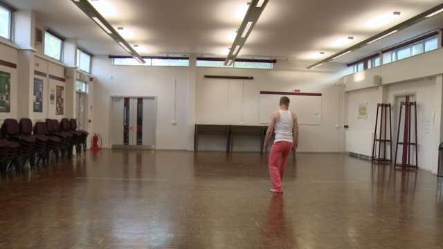 ms man practicing dance routine in community centre / berlin, germany - modern dancing stock videos & royalty-free footage