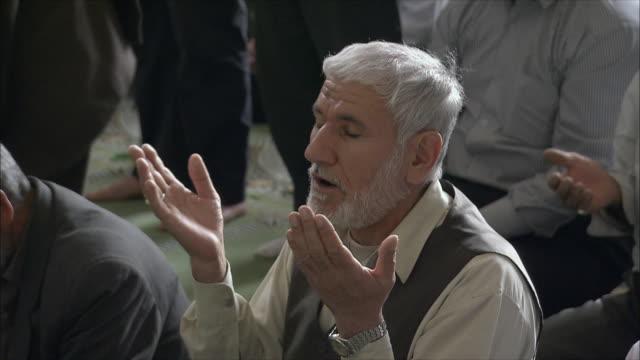 MS Man praying in Imam Mosque, Esfahan, Iran
