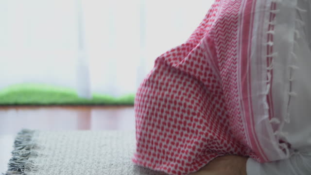 man praying, side shot with copy space. - islam stock videos & royalty-free footage