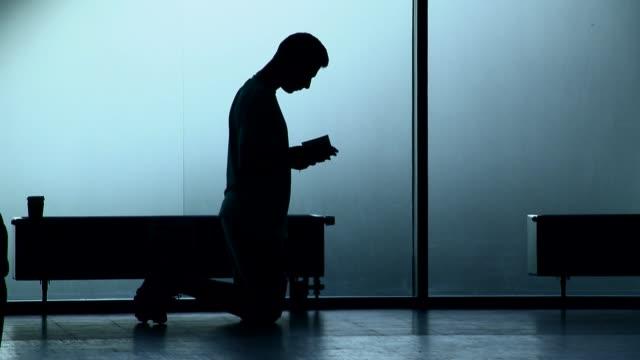man praying - kneeling stock videos & royalty-free footage