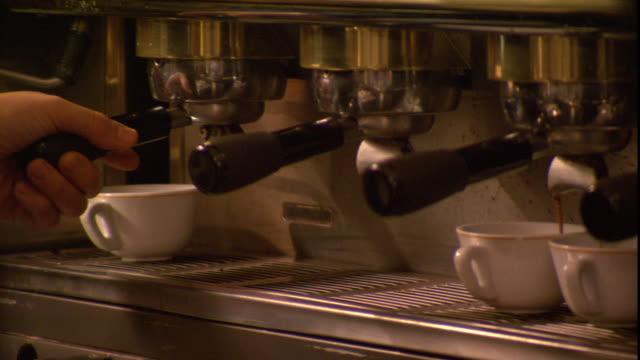 a man prepares a cappuccino. - jug stock videos & royalty-free footage