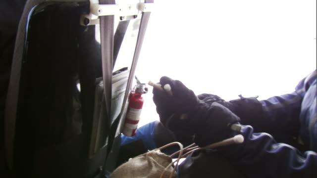 a man prepares an avalanche control dynamite pack. - 麻袋点の映像素材/bロール