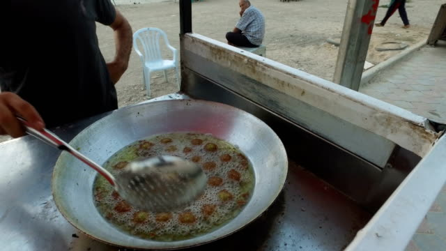 A man prepares falafel at a food stand on the beach For the past ten years Gaza residents have lived with constant power shortages in recent years...