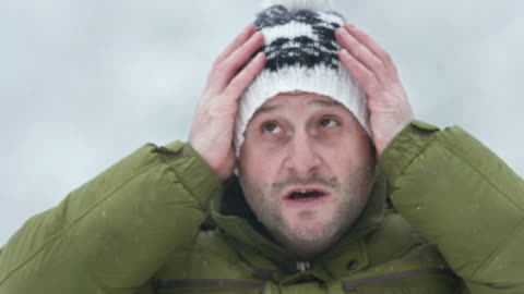 hd: man prepares for the cold weather - cold temperature stock videos & royalty-free footage