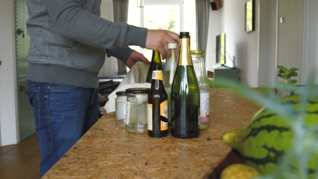 Man Prepares Glass Bfor Recycling at Home