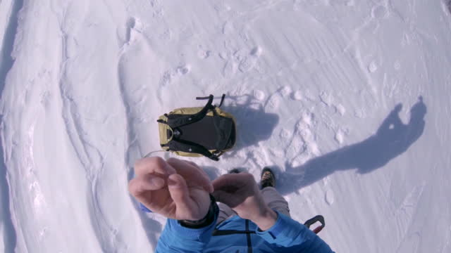 a man prepares to go speed flying riding in the snowy mountains. - wrist watch stock videos & royalty-free footage