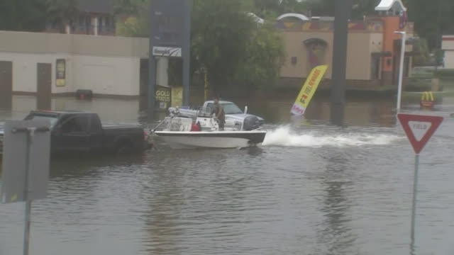 man prepares to launch boat in hurricane harvey floodwater in dickinson texas 08/28/17 - environment or natural disaster or climate change or earthquake or hurricane or extreme weather or oil spill or volcano or tornado or flooding stock videos & royalty-free footage