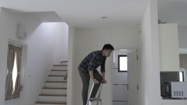 man preparing and improving his own house - adjusting stock videos & royalty-free footage