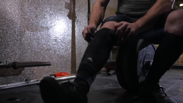 man preparing before weightlifting - toughness stock videos & royalty-free footage