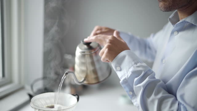 man preparing coffee - preparation stock videos & royalty-free footage