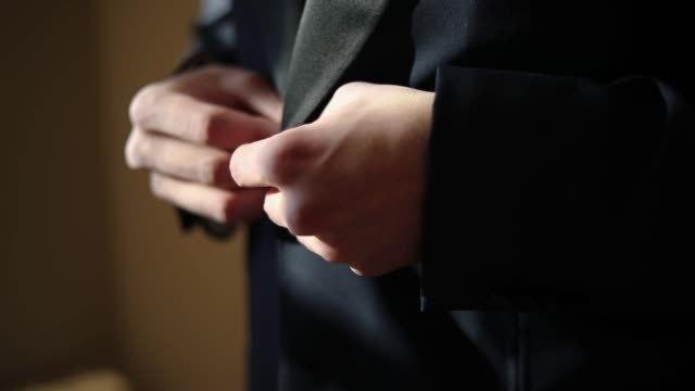man preparing for a wedding day, trying on black suit - life events stock videos & royalty-free footage
