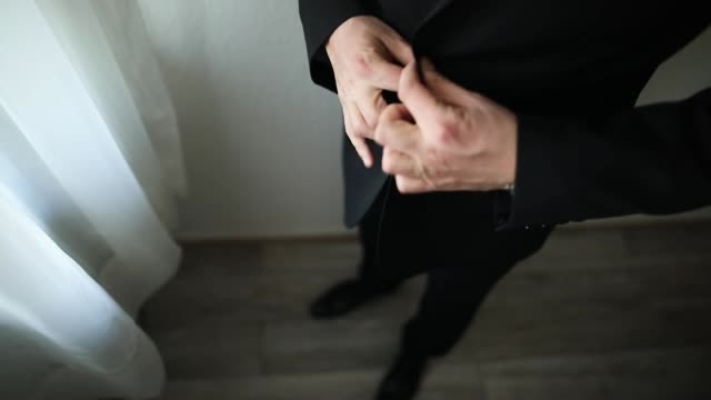man preparing for a wedding day, trying on black suit - handsome people stock videos & royalty-free footage