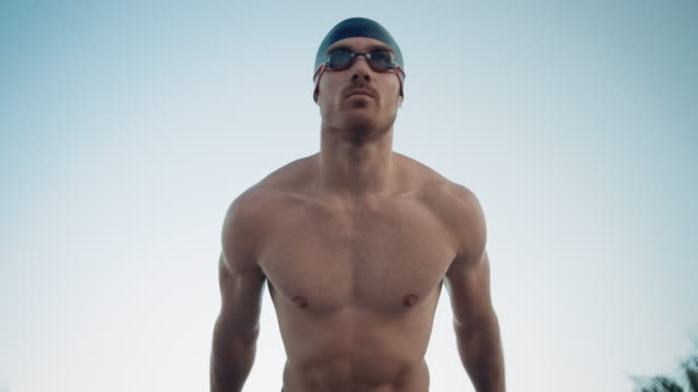man preparing for swimming - swimming goggles stock videos & royalty-free footage