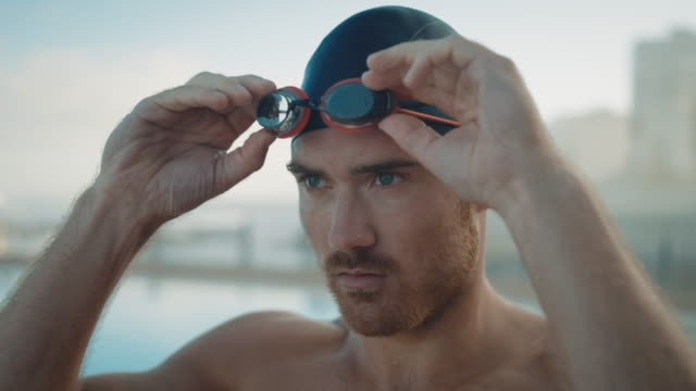 man preparing for swimming - cap stock videos & royalty-free footage