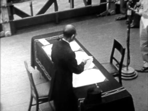 w ha man preparing paperwork on table on board of naval vessel during japanese surrender - japanese surrender stock videos and b-roll footage