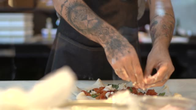 man preparing pizza at a commercial kitchen - tattoo stock videos & royalty-free footage