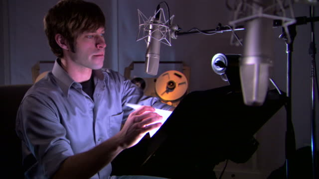 man preparing script in recording studio - see other clips from this shoot 1429 stock videos & royalty-free footage