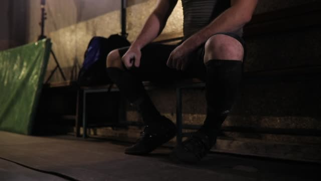 man preparing socks before weight training - concentration stock videos & royalty-free footage