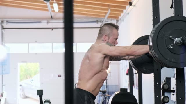 Man preparing to lift heavy weights at a functional gym