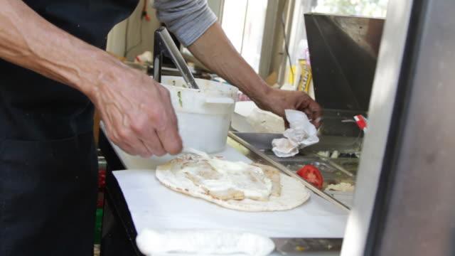Man Preparing Tortilla Wrap In Restaurant Trailer