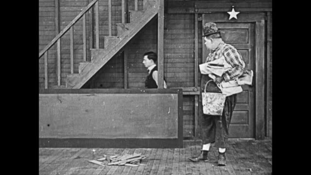 1919 man (buster keaton) pretends to walk down imaginary stairs while man (fatty arbuckle) watches - illusion stock videos & royalty-free footage