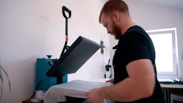 man printing text on t-shirt - shirt stock videos & royalty-free footage