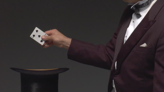 ms man producing cards from hand and throwing them into top hat - magic trick stock videos & royalty-free footage