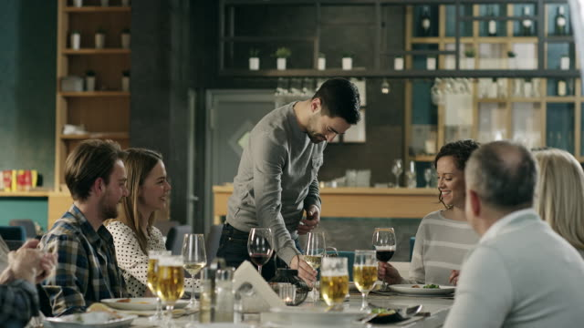 man propose women on family dinner in restaurant - multi generation family stock videos & royalty-free footage