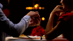 Man proposing beloved lady at romantic dinner in restaurant on st Valentines day