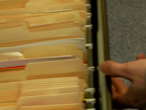 cu, man pulling file from file cabinet drawer, close-up of hands - filing cabinet stock videos and b-roll footage