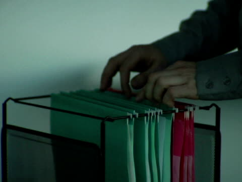 cu, man pulling paper from hanging folder, close-up of hands - file clerk stock videos & royalty-free footage
