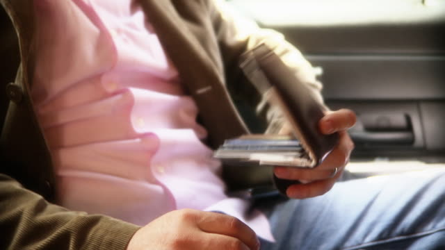 a man pulls a credit card out of his wallet. - wallet stock videos & royalty-free footage