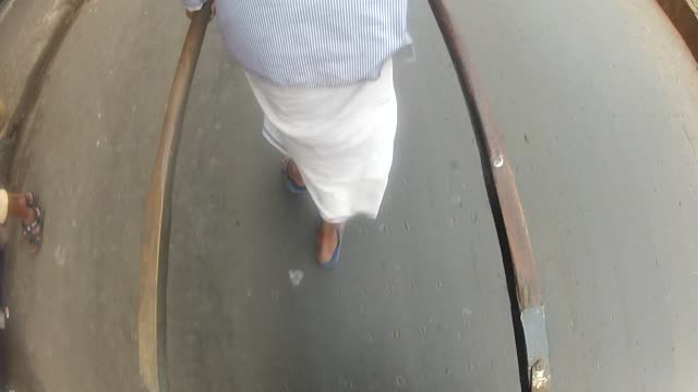 a man pulls a rickshaw along a street in india. - rickshaw stock videos and b-roll footage