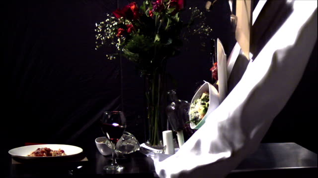 a man pulls a tablecloth out from under table settings, upsetting wine and food dishes. - place setting stock videos & royalty-free footage