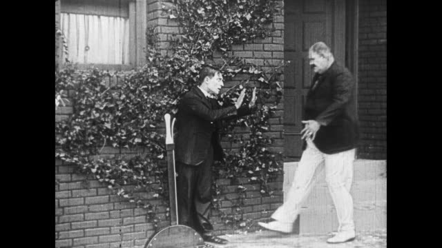 1922 Man (Buster Keaton) pulls lever to fill and refill pool