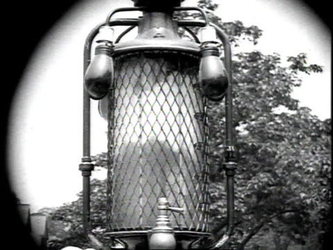 1926 montage man pumping gas and gas line lowering in glass pump top / united states - 1926 stock videos & royalty-free footage