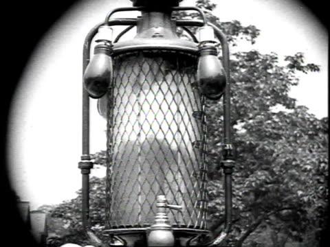1926 montage man pumping gas and gas line lowering in glass pump top / united states - 1926 bildbanksvideor och videomaterial från bakom kulisserna