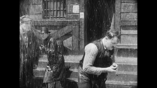 1928 a man punches a sheriff in the rain - 1928 stock videos & royalty-free footage