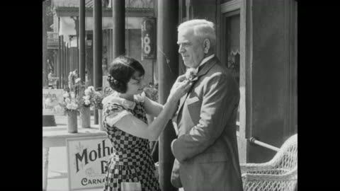 1928 a man (tom mcguire) purchases a mother's day carnation - mother's day stock videos & royalty-free footage