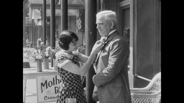 1928 a man (tom mcguire) purchases a mother's day carnation - carnation flower stock videos & royalty-free footage