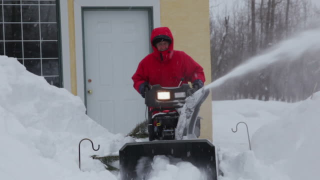man pushing snow blower - snowplough stock videos & royalty-free footage
