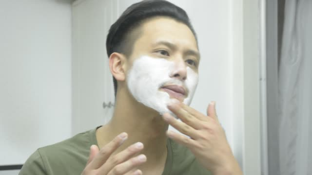 man put shave cream on face in toilet - face cream stock videos and b-roll footage