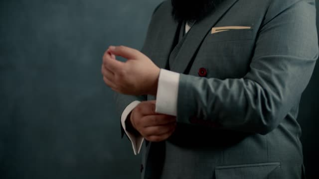 man puts cufflinks on sleeves of white shirt - masculinity stock videos & royalty-free footage
