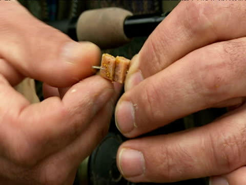 Man puts diced meat bait on fish hook