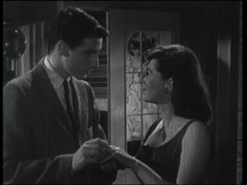 b/w 1957 man puts engagement ring on woman's finger, they kiss for a long time - fidanzata video stock e b–roll