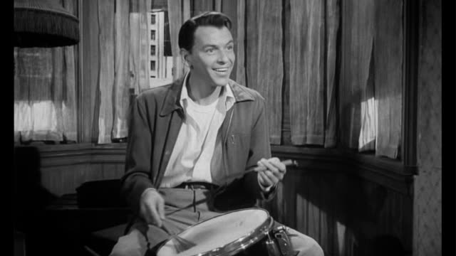 1955 man (frank sinatra) puts his musical talents on display for handicapped woman (eleanor parker) - musician stock videos & royalty-free footage