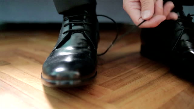 man puts on shoes - shoe stock videos & royalty-free footage