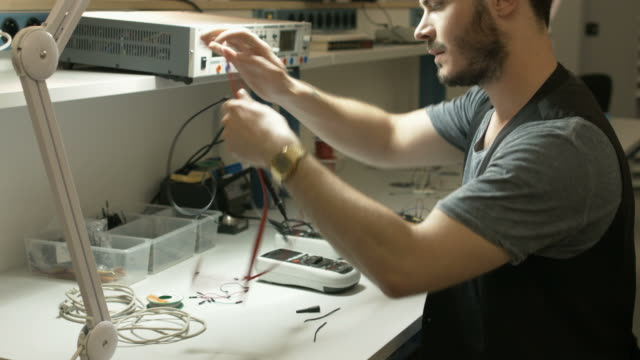 man putting away electronic test equipment - vanguardians stock videos & royalty-free footage