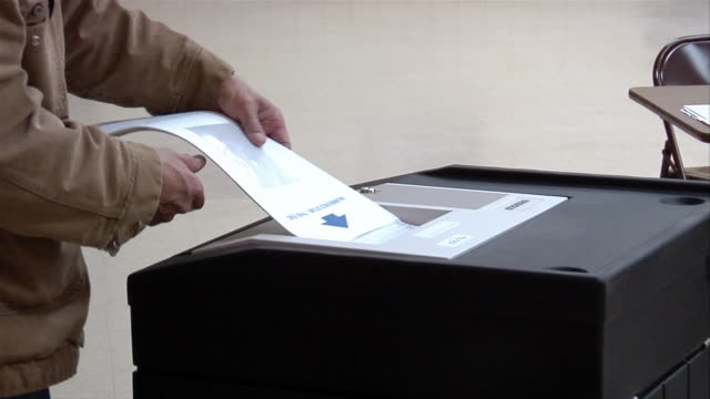 cu, man putting ballot into machine, ypsilanti, michigan, usa - ypsilanti stock videos & royalty-free footage